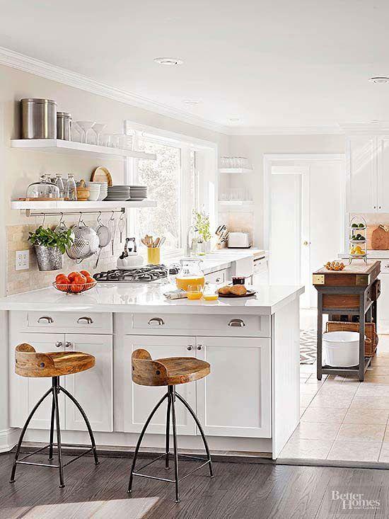 Beautiful white kitchen (love the wood stools!)