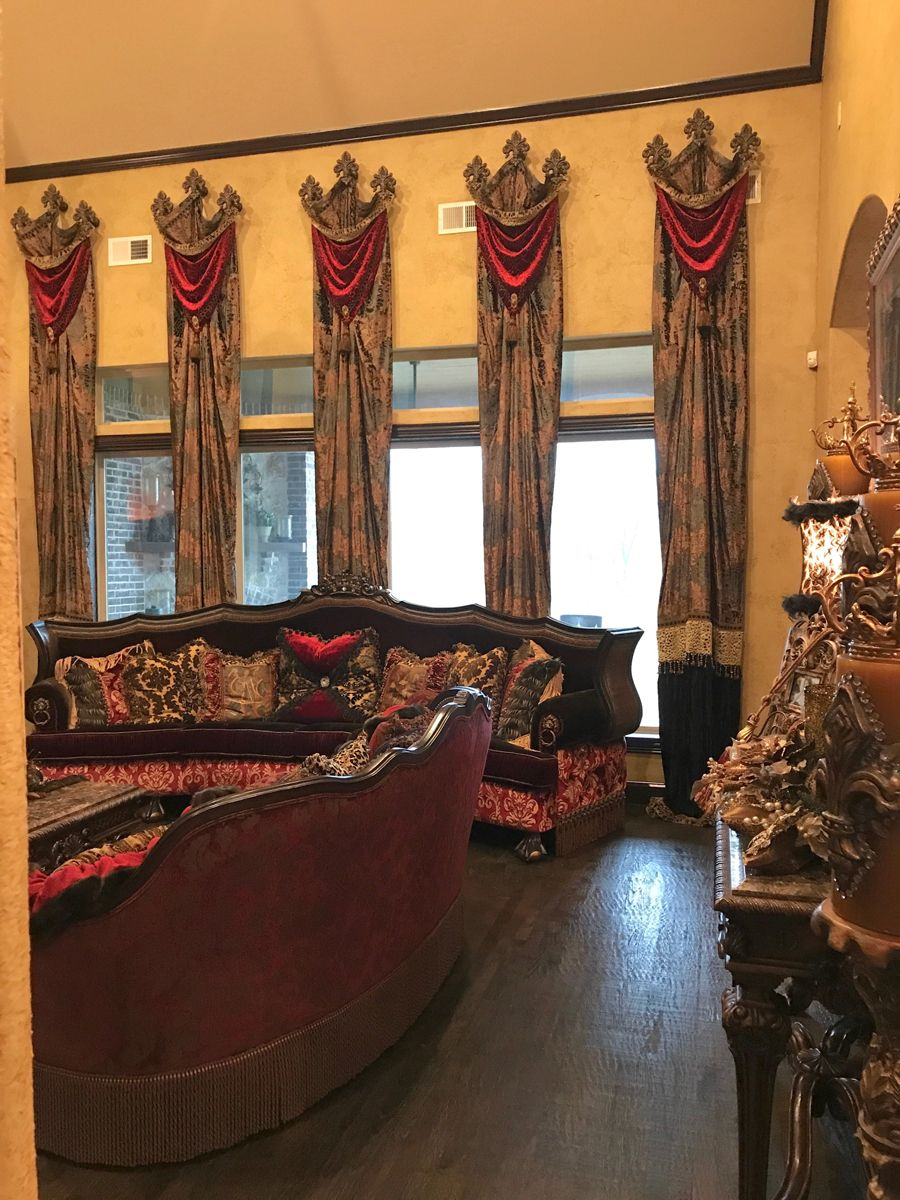 Luxury window treatment panels with swag overlays hung on medallions