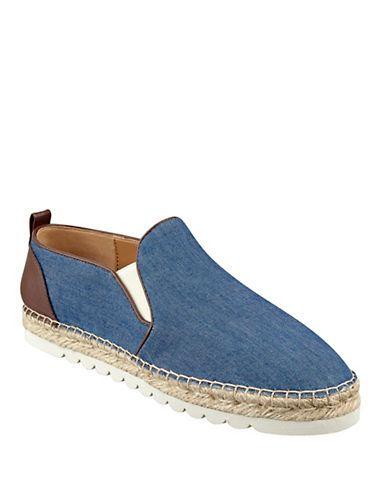 <ul> <li>Loafer inspired slip- on with an espadrille sole</li>  <li>Fabric upper</li>  <li>Synthetic lining</li>  <li>Rubber sole</li>  <li>Lightly padded insole</li>  <li>Imported</li> </ul>