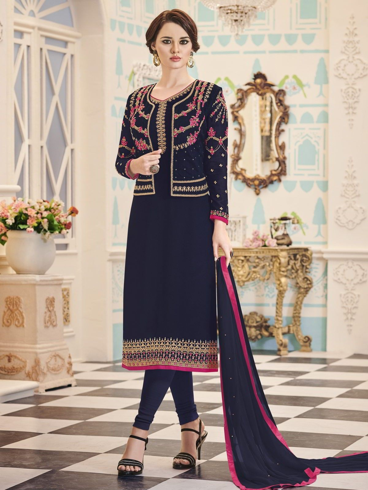 619c8fe185 Charming navy blue partywear straight cut suit with koti online which is  crafted from georgette fabric with exclusive embroidery work.