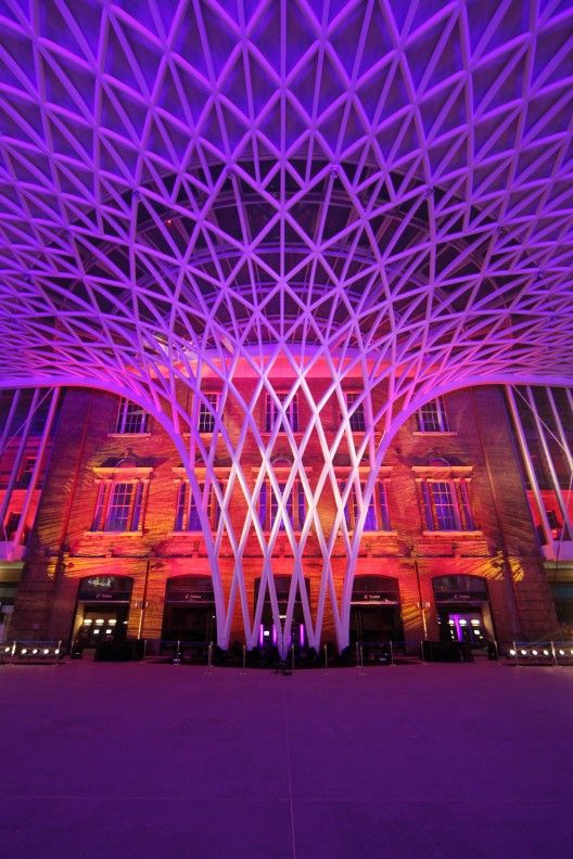 The new lattice-roofed concourse of Kings Cross station, lit up for a preview event.