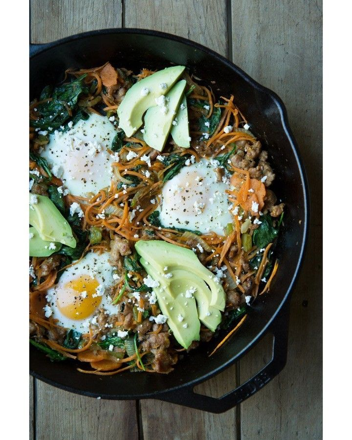 Sweet Potato Breakfast Skillet . Prep time: 10 minutes Cook time: 15 minutes Serves: 3-4 people . 4 tablespoons coconut oil 1/2 medium onion diced (1/2 cup) 1/2 green pepper diced (1/2 cup) 2 cloves garlic minced 1/2 pound grass fed ground beef or 2 italian sausages casing removed 2 cups shredded sweet potato 2 cups spinach 3 eggs goat cheese to garnish avocado to garnish . Instructions: 1 Turn your ovens broiler on high 2 Preheat a 12 inch cast iron skillet over medium heat and place your…
