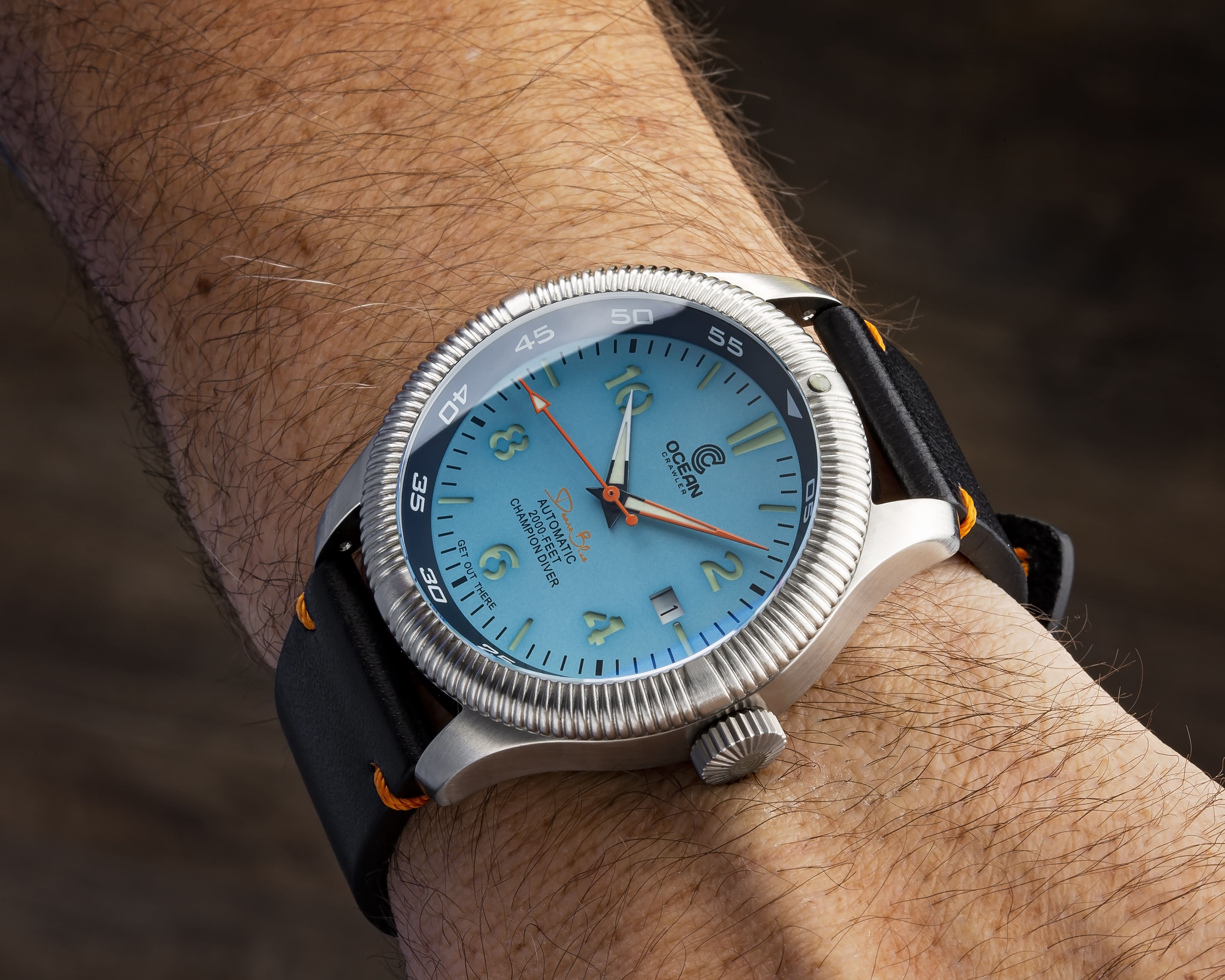 wrist shot of the teal dial ocean crawler champion diver dean s blue hole is a blue dive hole located in the b dive watches watches for men best gifts for men teal dial ocean crawler champion diver