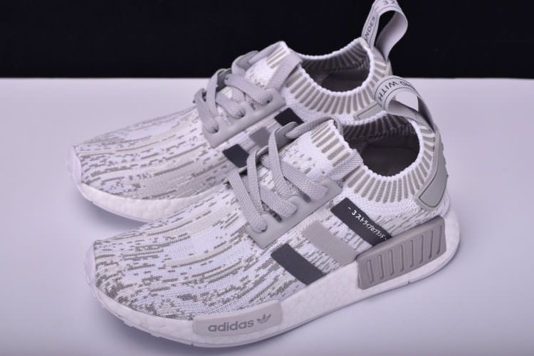 9e47f3e736adc Adidas NMD R1 Primeknit Grey Glitch Camo use of the simple atmosphere of  the gray camo Primeknit uppers