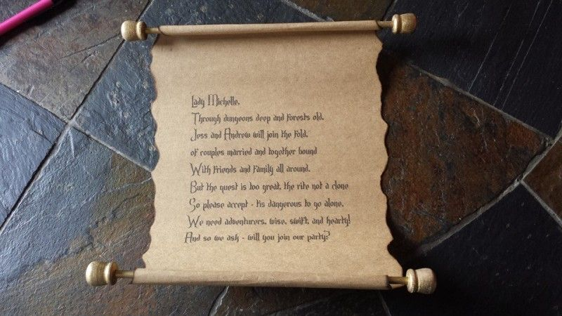 Propose to your adventuring party with these Medieval scroll invites