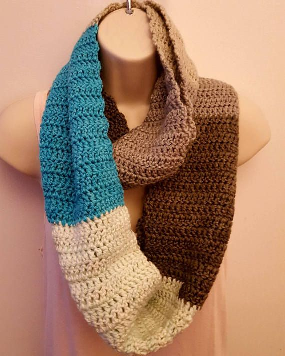 Soft Striped Infinity Scarf  You are going to LOVE this striped infinity scarf! The blue, grey, and white flow together beautifully and is a perfect way to add a pop of color to any outfit. It is 100% hand-crocheted. It is very long and can be worn in a variety of ways.  CARE: Hand-wash and lay flat to dry  MATERIALS: 80% Acrylic, 20% Wool (If you would like to know the specific yarn used, please feel free to send a private message).  MEASUREMENT: (approximate) Width = 9 inches Length &#...