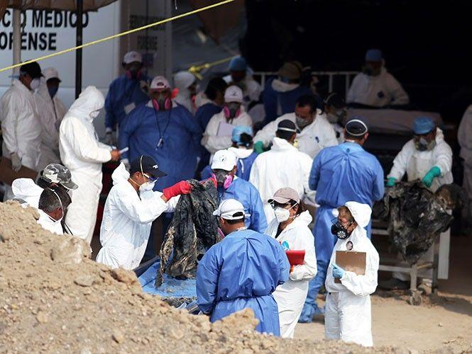 Hallan 2 niños y un feto entre 117 cuerpos exhumados en Tetelcingo   El Puntero