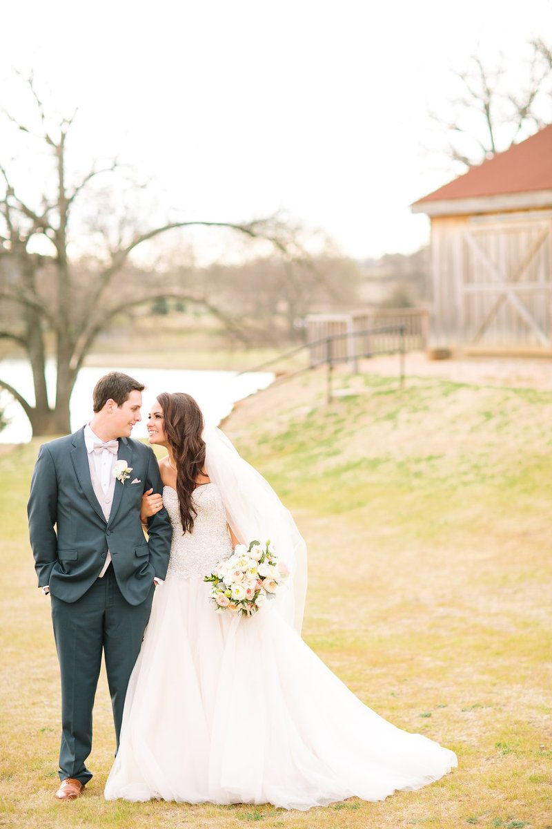 Silver & Lace vintage barn wedding.  photo by The Tarnos.  Bride and Groom.