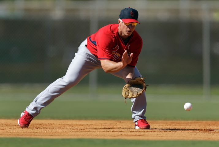 Mark Ellis fields a grounder while working out at second base during spring training 2014