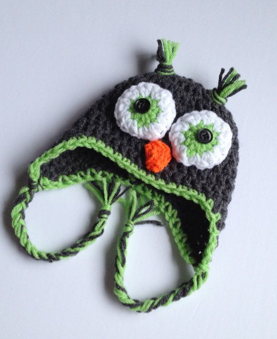 $15.00 - Baby boy charcoal gray and lime green crochet owl beanie hat with flaps and braids, size Newborn 0-3 Months, 3-6 Months or 6-12 Months. This hat is super cute for any baby boy or small boy! It is starting to get cold out, so now is a great time to buy. It's also a thoughtful gift for Christmas!