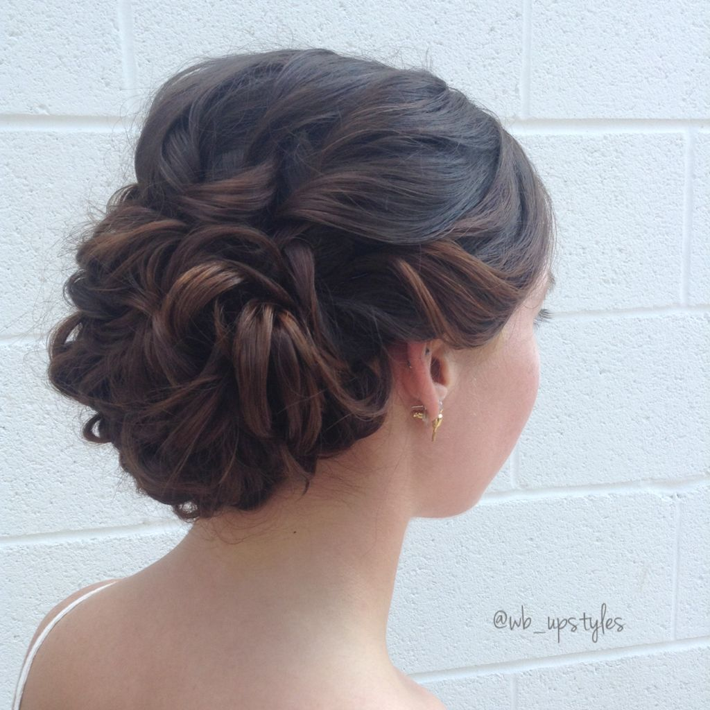 Gorgeous wedding hairstyle swept back romantic low with curls