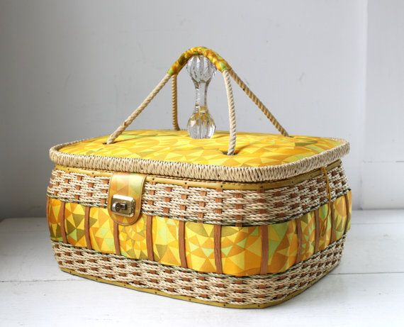 Vibrantly colored midcentury round sewing basket Rope handle on lid. This wicker and wood sewing basket is lined colored fabric of the 60s