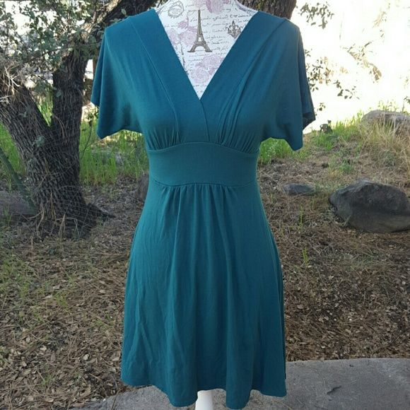 Cute mini dress Turquoise mini dress. Low cut in front. Low cut in back, around mid back area. In excellent condition. Minty Dresses Mini