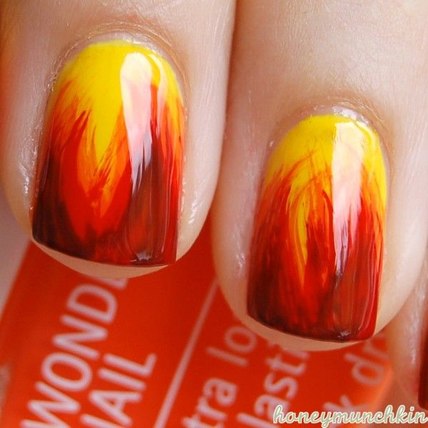 Fire Nails detail reminds me of (what I imagine) Katniss's nails would look like when she gets dolled up for the hunger games.