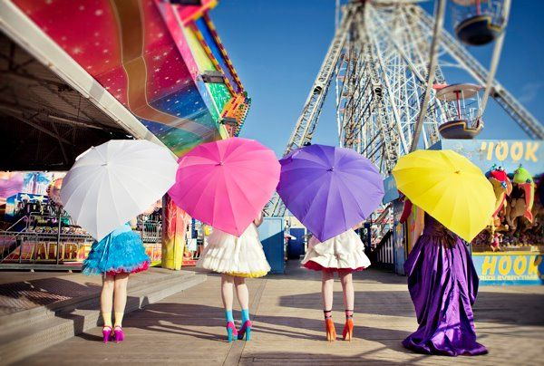 Carnival bridal photo shoot in Blackpool, UK. Heart shaped umbrella from Love Umbrellas