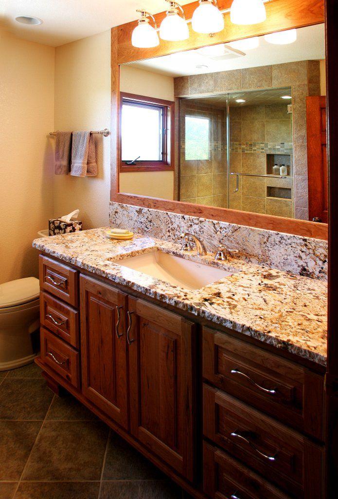 Granite bathroom countertops with dark wood cabinets ... on Bathroom Ideas With Black Granite Countertops  id=17648