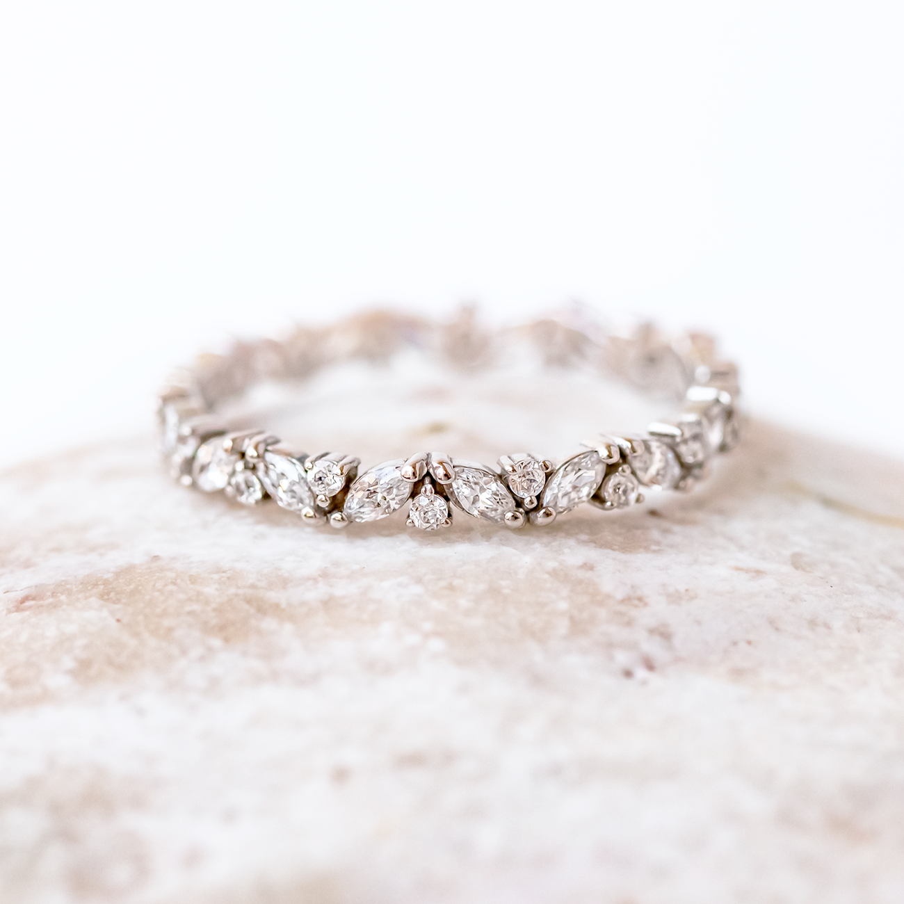 Our Haley diamond wedding band is set eternity style with alternating marquise and round Canadian diamonds.  #diamondweddingband #weddingband #eternity #diamond