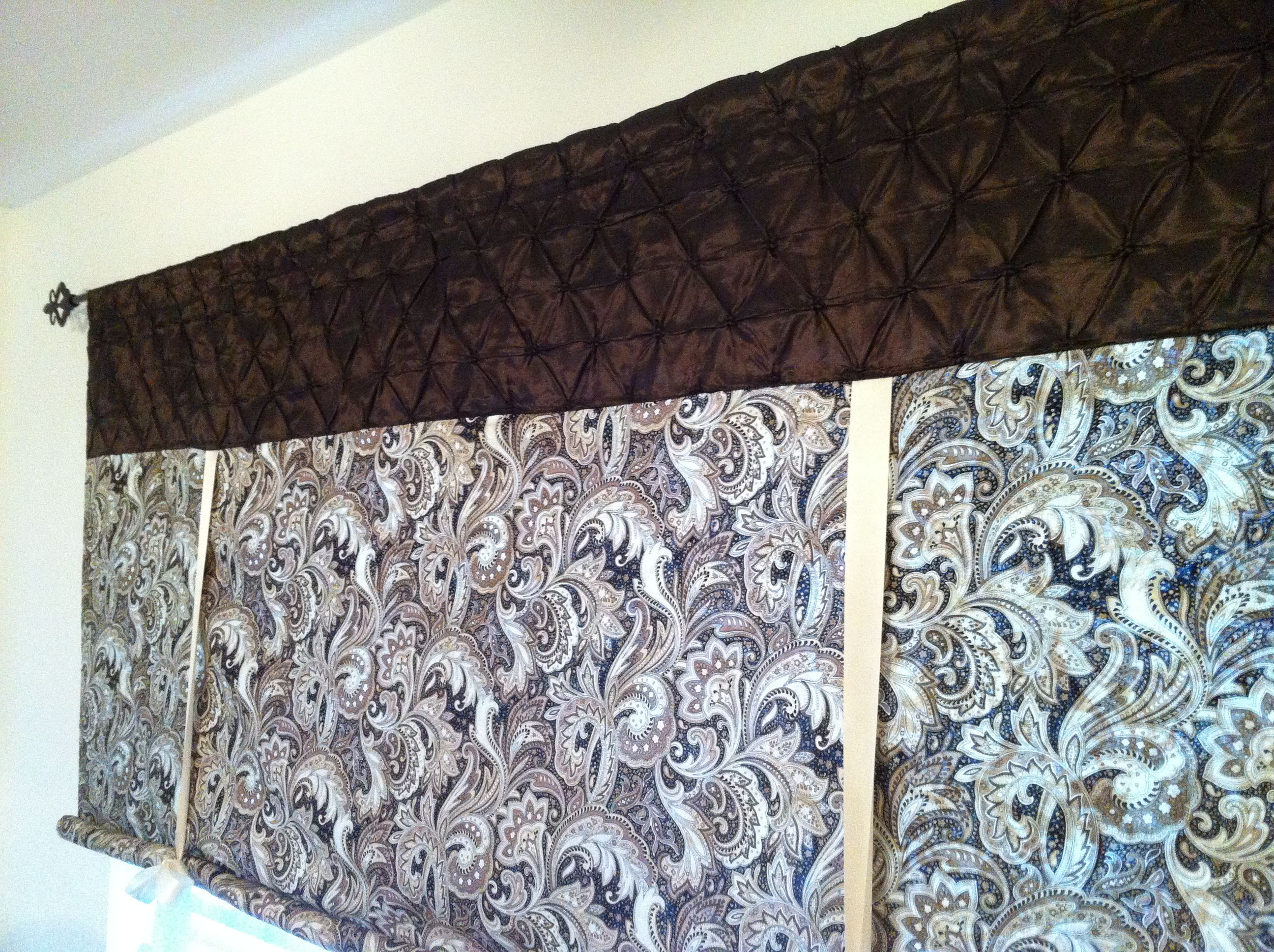 Upclose shot of the curtains. Neutral paisley fabric has black, brown, knakis and cremes. Found it online and had to have it!  The silk is a lovely chocolate brown with button pintucks.  So, so happy with them!!