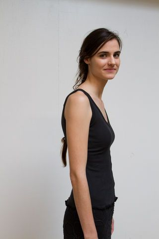 """Our 100% organic cotton lightweight rib-knit tank top features center front and center back seams, a pulled hem, and a deep v-neck. Measures approximately 23"""" from top of the shoulder to the bottom hem. Machine-sewn in Alabama."""