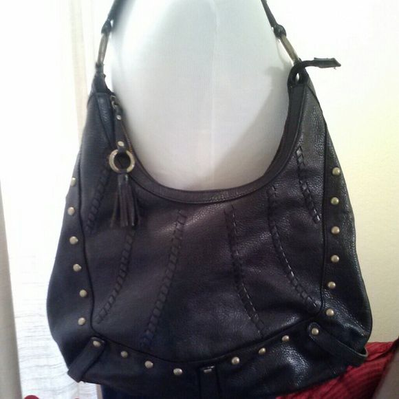 Black leather bag Great black bag brass studded detail.  In excellent condition.  No marks in lining, hardly used.  Very durable leather.  Good bag for everyday use.  Measures 18 inches length, 16 inches height from top zipper, from strap to bottom 22 inches Bags