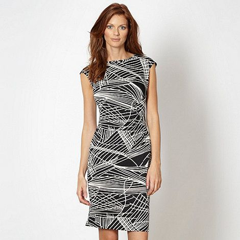 This #black jersey #dress has a standout #tribal print. Pair with a pair of #black heels for a chic office style. #SS14