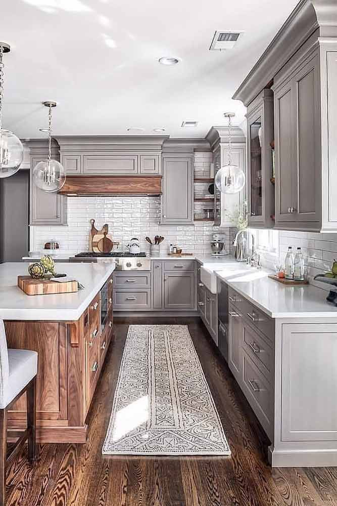 Gray Kitchen With Wooden Accents #woodenisland #graycolors ★ Find your dream design among these modern kitchen ideas. Make remodeling and decoration fun and easy, not to mention affordable! #kitchenideas #kitchen #kitchengoals