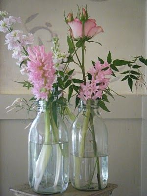 Milk Bottles Make Great Additions To A Cluster Of Arranged Flowers From Jewel Box Blog Easter Goodies Pass Wedding Flowers Flower Decorations Floral Display