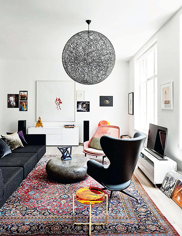 Traditional rugs don   just belong in spaces loving the element of surprise  persian style rug brings to this contemporary living room elle also home ideas pinterest classic