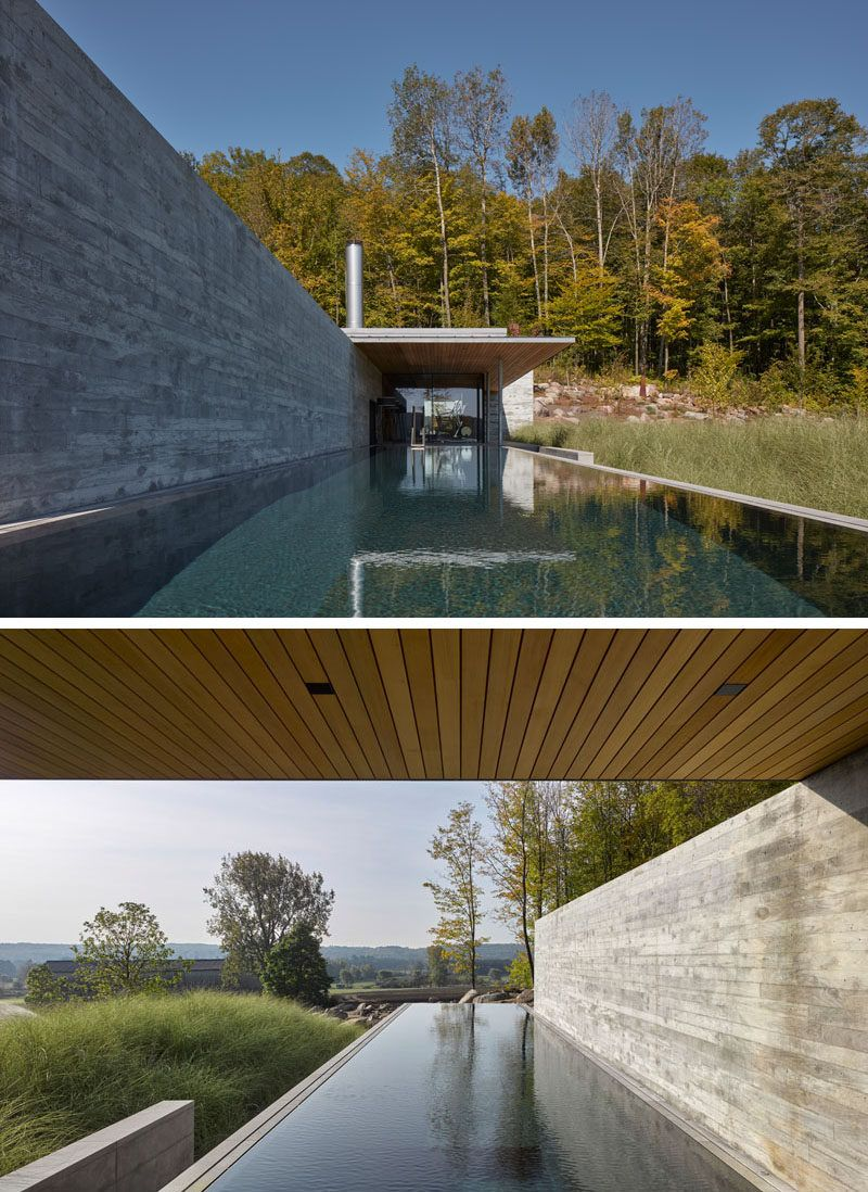 This Modern Concrete Wood And Glass Pool House Sits Next To An Infinity Lap Pool And Hot Tub And Features An Outdoor Fi Pool House Pool Houses Concrete Pool