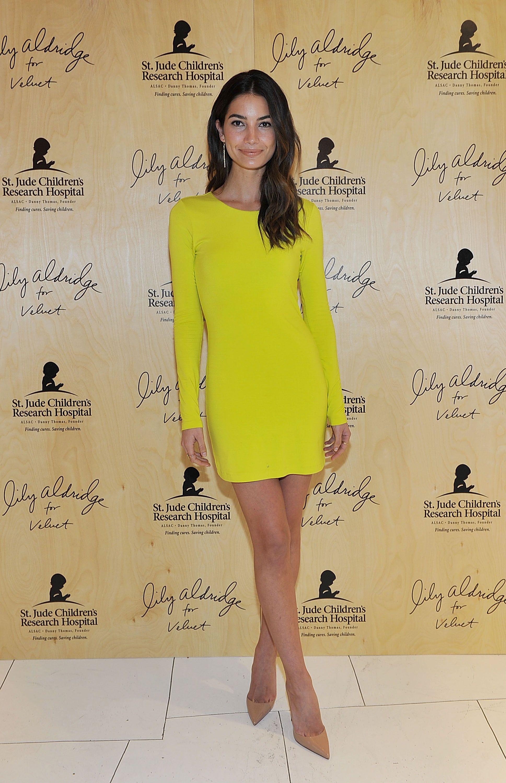 Lily aldridge wearing a chartreuse longsleeve mini dress and nude