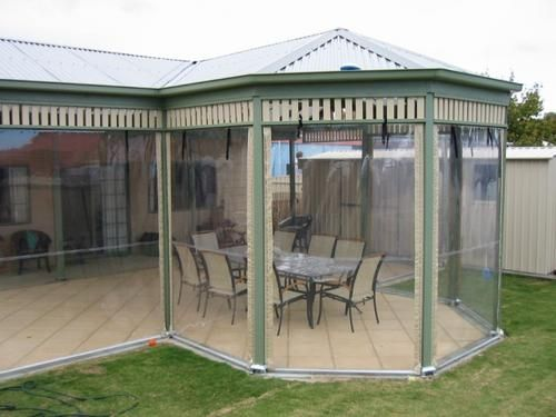 External View Of Enclosed Pergola With Hip Ends And