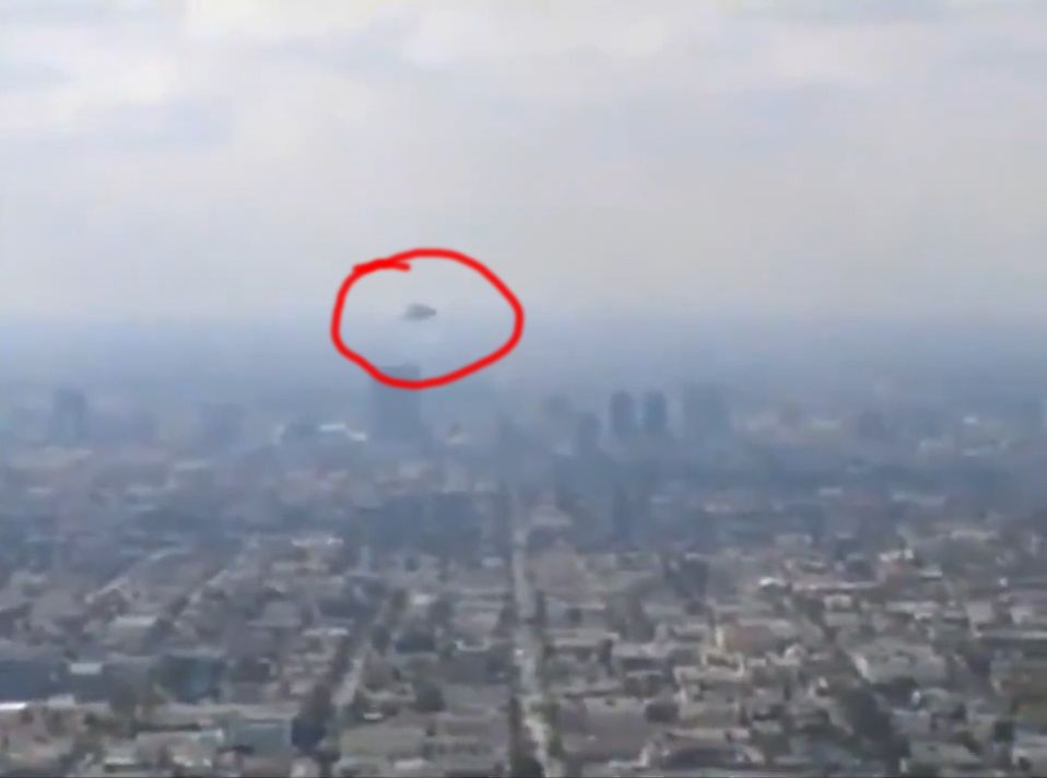 Real alien spacecraft hovering over cities caught on video. Sounds of military explosions heard in the distance!