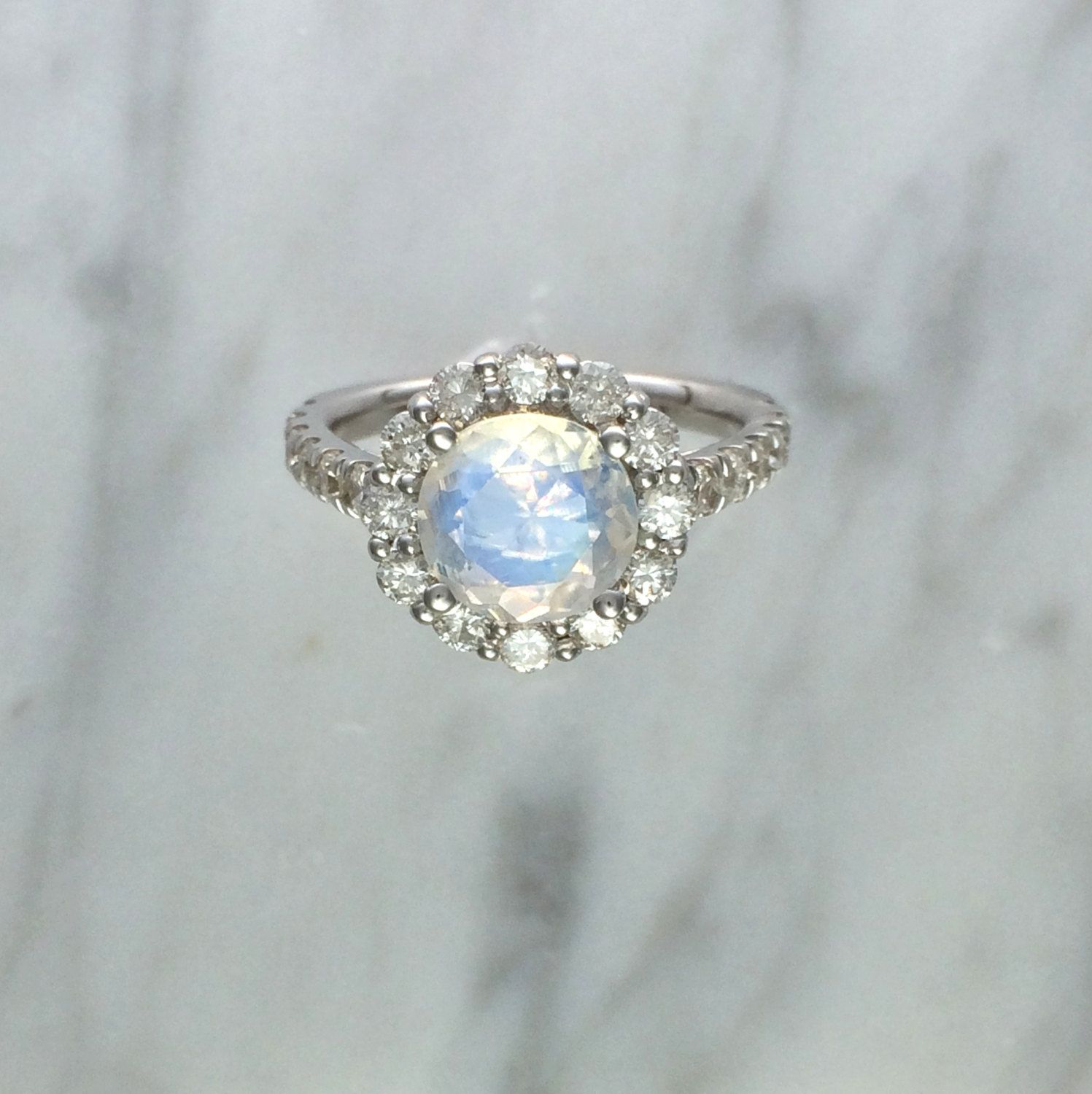 Blue rainbow faceted moonstone w round diamond halo setting in k