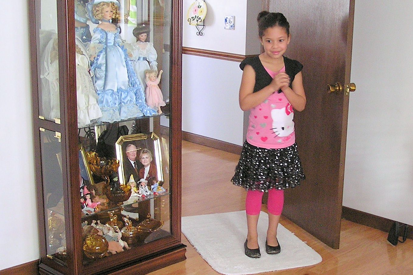 12-2011 Christmas.  She walks in and see her dollhouse.