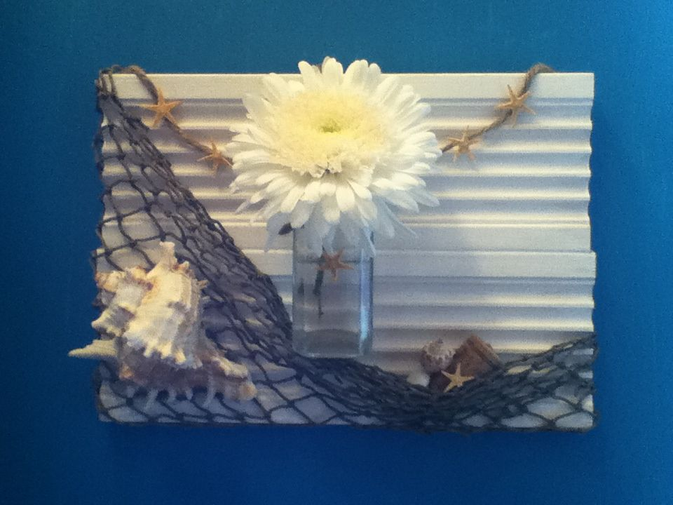 To wooden boards,painted, glued, and blinged out. A small glass bottle hung from the front to put fresh flowers in :)