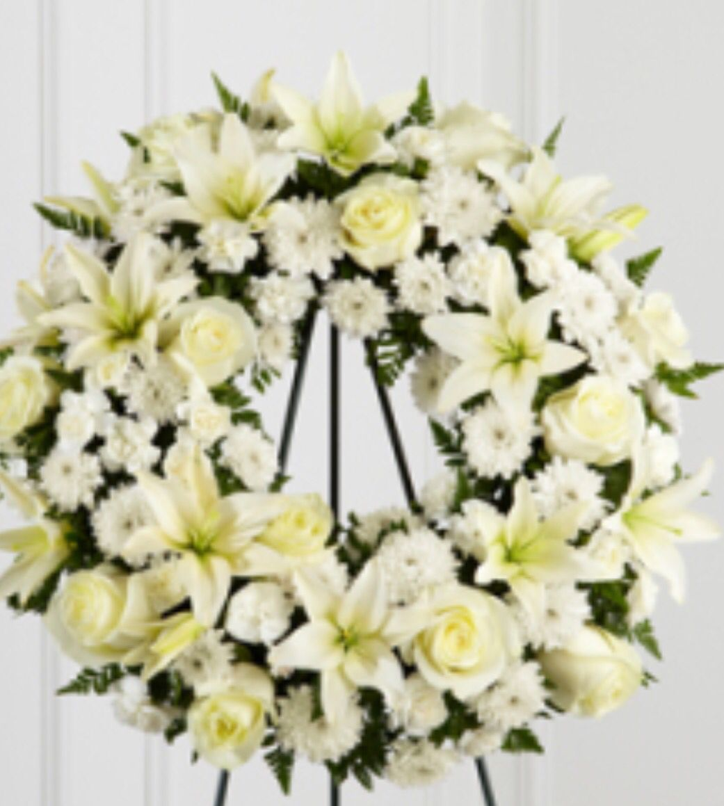 Pin by camps on fleurs blanches papillon pinterest the ftd treasured tribute wreath offers peaceful wishes of heartfelt sympathy with each delicate bloom bright white roses asiatic lilies izmirmasajfo