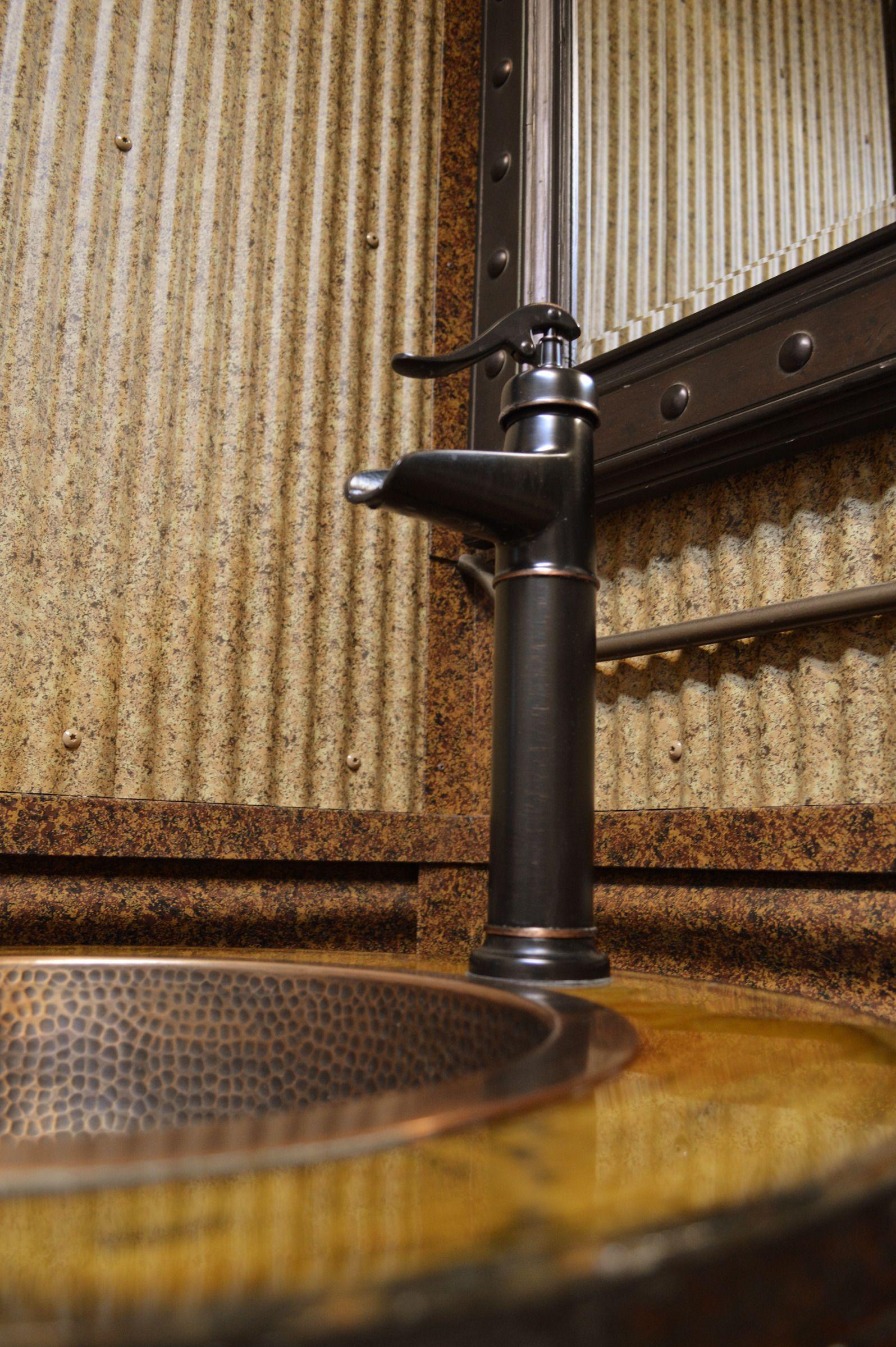 rustic corrugated metal on bathroom wall. | metal accents