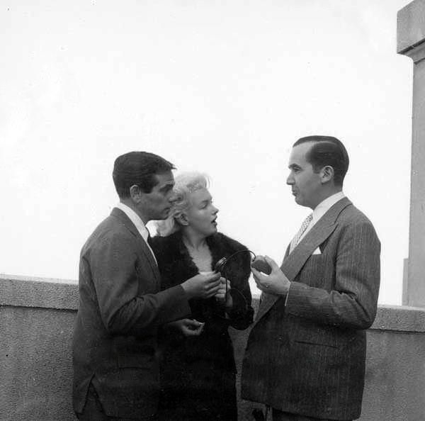 Marilyn with Milton Greene and broadcast journalist Edward R. Murrow, 1955.