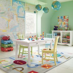 Love the bright colors. Cute ideas using the maps as artwork and the globes hanging from the ceiling