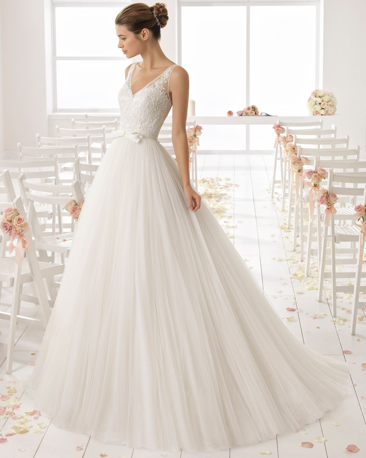 A line beaded lace and tulle wedding dress with V neckline and low