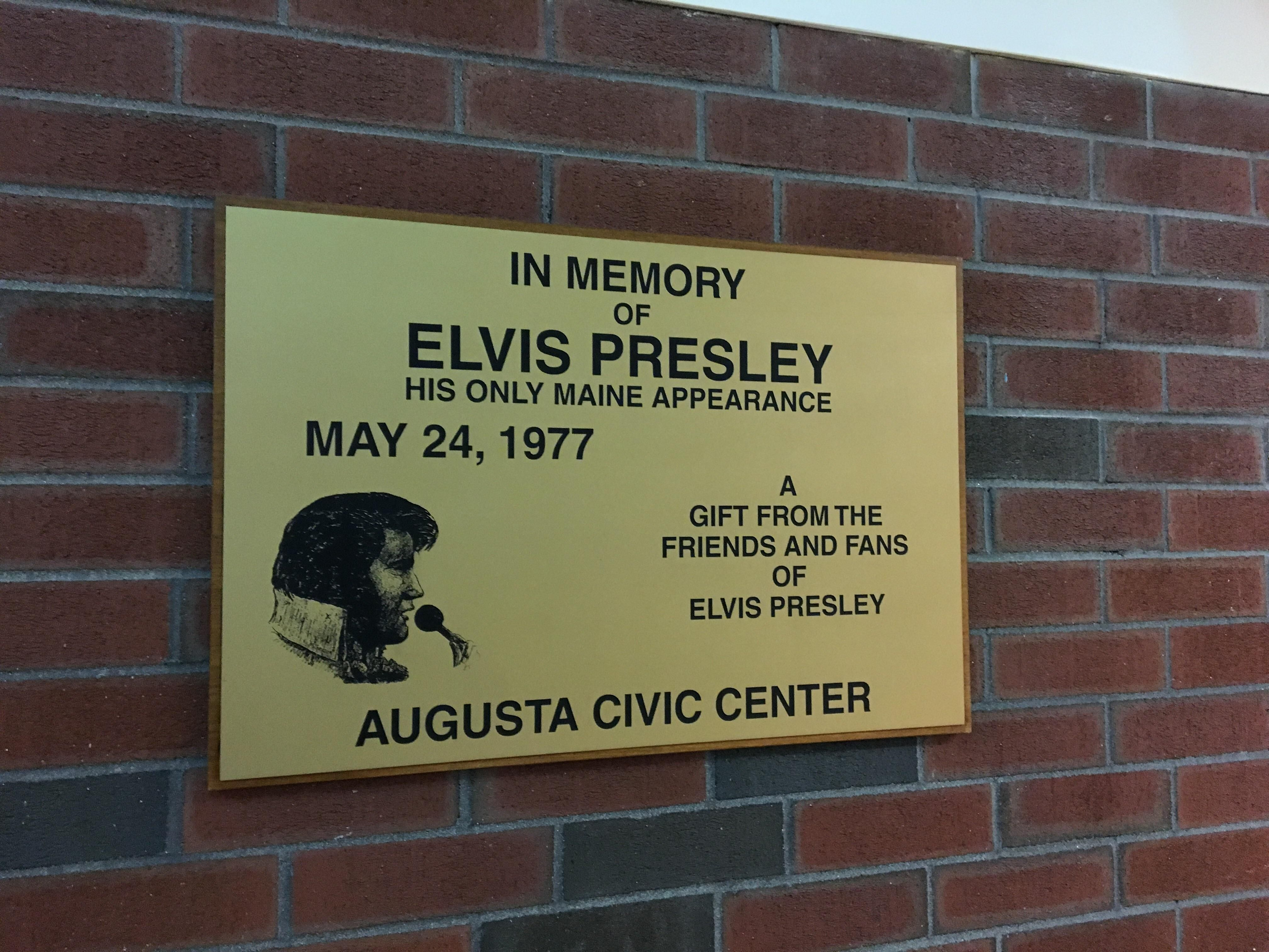 Plaque hanging on the wall at the Augusta Civic Center in