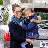After hitting Paris Fashion Week , Jessica Alba returns to mommy duty on Tuesday, taking a giddy Honor, 3, to school in Santa Monica