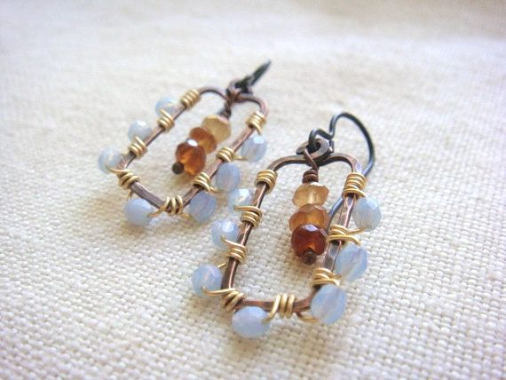 Created from oxidized and hand-polished copper wire frames which are wrapped with brass wire for a nice contrast. The beads are Czech. In the center of the earrings, three Hessonite amber  garnets in a gradation of darker to lighter. The ear wires are niobium, which is generally a safe choice if you are metal sensitive.   The earrings measure approximately 1-1/4 inches long. The pendants measure approximately 1-inch by 5/8-inches. The beads measure approximately 1/8-inches (about 4mm).