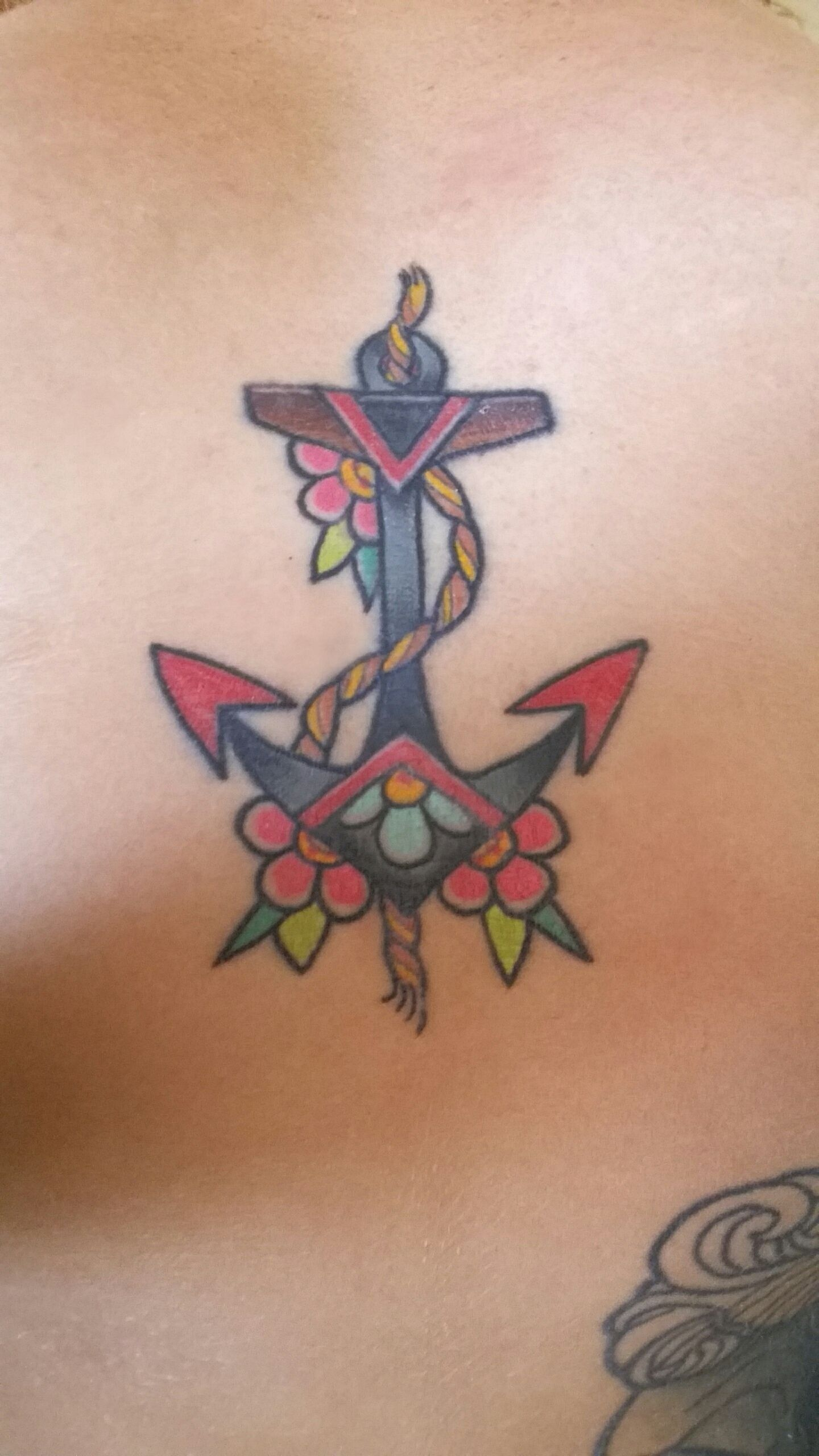 Traditional anchor w/ posies chest tattoo