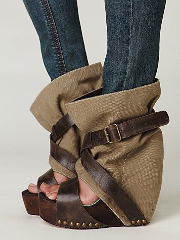 Levon Platform  Platform wedge with canvas upper. Criss-cross leather straps with buckle closure. Resin composite sole.    What is this??? A try but a miss