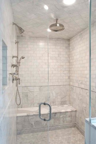 The Seat Slab Is Calcutta But The Rest Is A Very Affordable Marble The Tile Shop Called Avenza Shower Tile Marble Showers Tile Bathroom