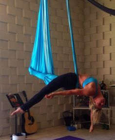 leg wrap with balance  aerial yoga poses aerial yoga