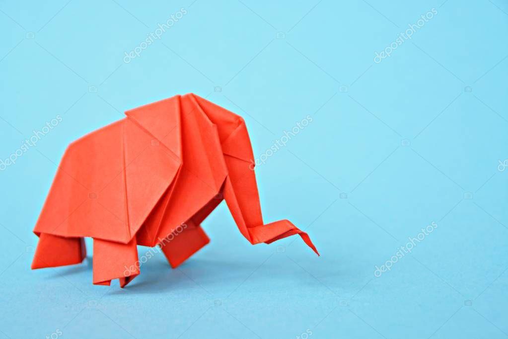 Photo of Origami Elephant Folded Red Paper Light Blue Background – Stock Photo , #spon, #…