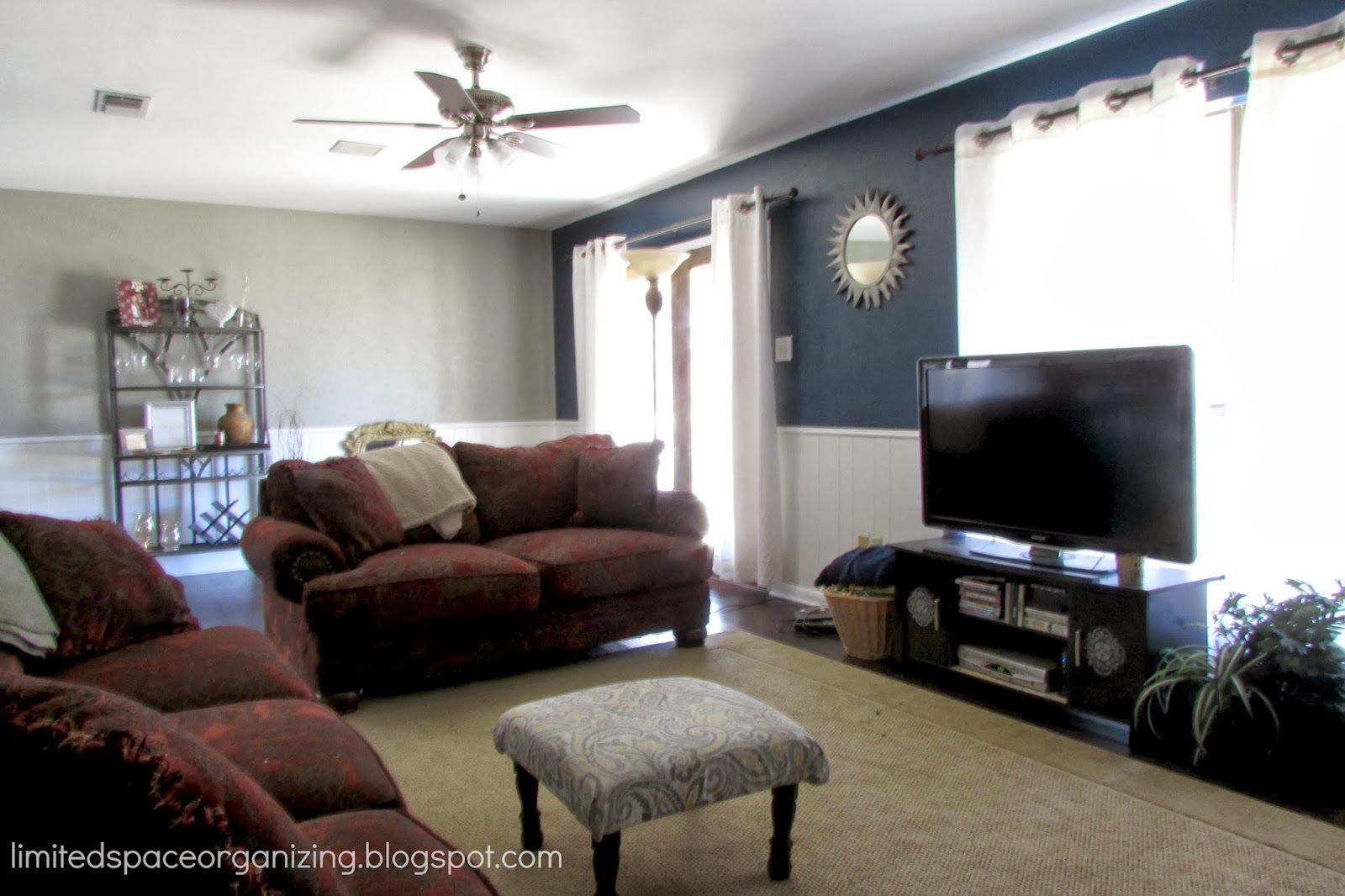 Greige and navy walls limited space organizing living room