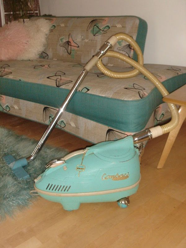 My parents had this vacuum - in gray.  I hated the chore of vacuuming because the canister was SO heavy to drag around.